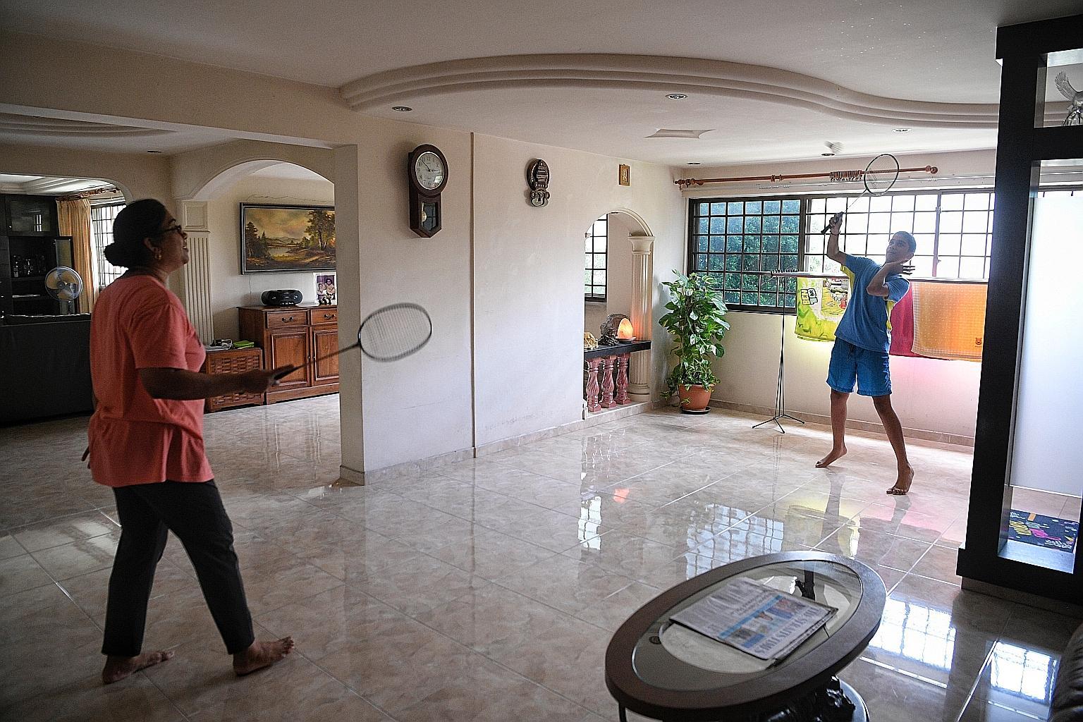A family playin badminton in their jumbo flat