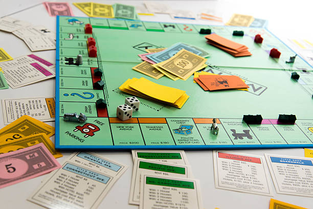 A Monopoly Board with money, property deeds and houses